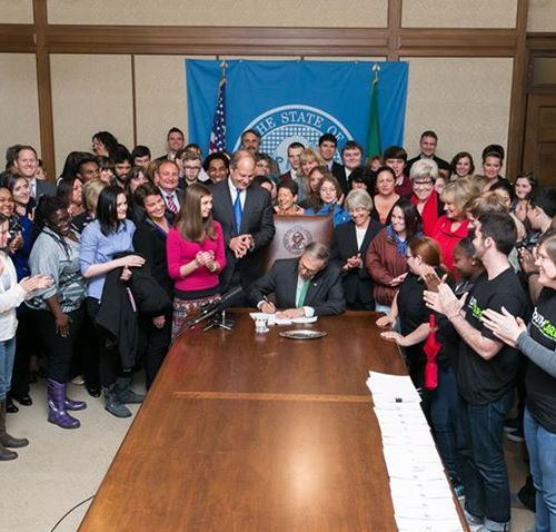Governor Inslee signing a bill