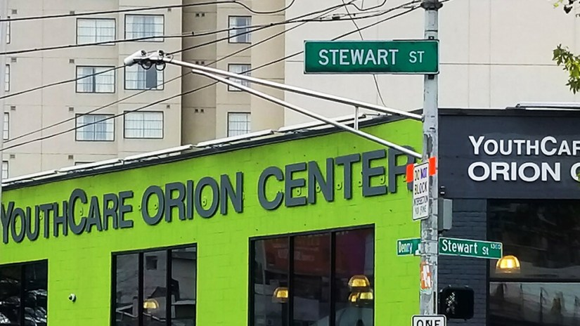 The Orion Center's bright green facade on Stewart and Denny