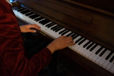 young person playing piano