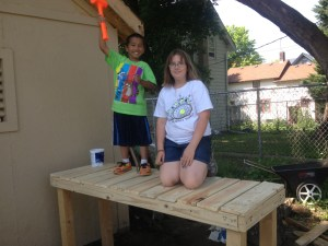 Youth farmers work on building the ultimate compost bin in Frogtown.