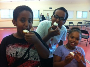 Youth farmers eat the cookies they baked on the first day of the Liberty Plaza after school class.