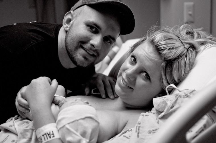 Mom holds baby skin to skin. A precious new family.