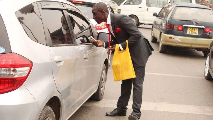 Image result for man selling pens in nairobi traffic