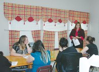 Dell volunteers facilitate etiquette workshop for girls at the Wallace Group Home.