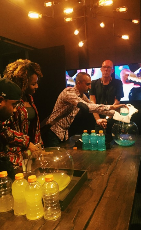 Riz showing Alvin Akintimehin Thater Mag and Ann Akineuoyn Playbook Agency how the product works on a shirt 540x876 - Event Recap: Crep Protect's U.S. Launch @crepprotect @NeueHouse #CrepProtect