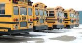 School buses sit idle during the single-digit temperatures of the previous weeks. (Photo by Megan Bachman)