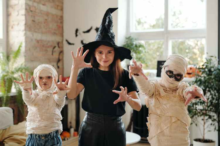 a family wearing halloween costumes
