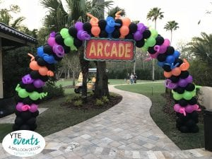 Arcade Themed neon arch for event black pink green orange blue purple blacklight