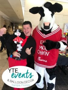 Chick fil a cow with Mr Fudge and Balloon caricature of mascot at grand opening