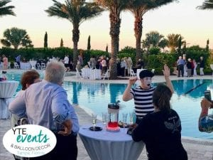 Mime making waves in Sarasota with corporate event by pool