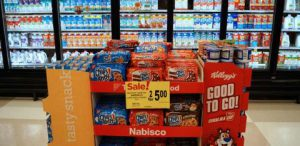 """These cardboard displays (""""shippers"""") allow Nabisco and Kellogg's to get their products in front of customers who skip the cookie and cereal aisles. Their placement near the dairy case suggests that customers buying milk should also buy cookies and cereal"""