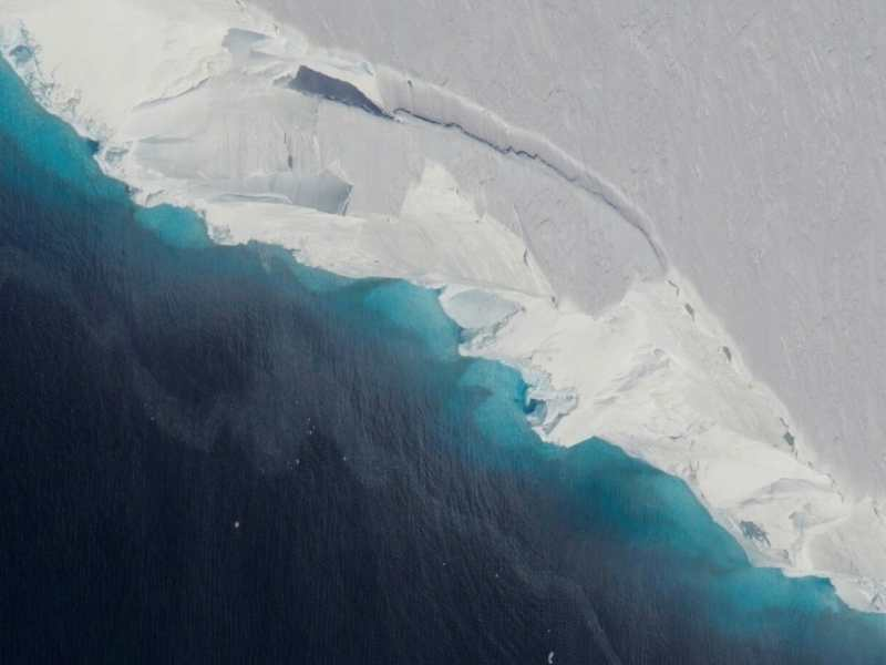 Part of Thwaites Glacier crumbles into the ocean. It is part of the normal life of a glacier, but the rate of ice flow into the ocean of some Antarctic glaciers has markedly accelerated, raising concerns. Credit: NASA/OIB Jeremy Harbeck