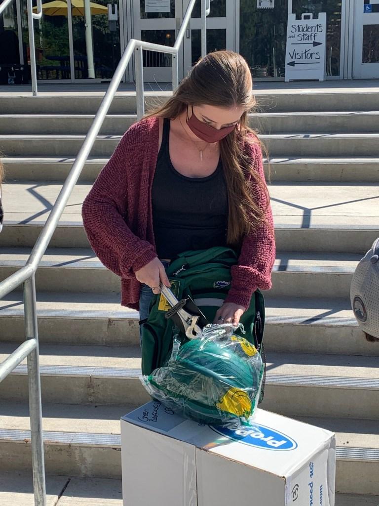 Nevada Union High School Senior, Marin Martin unpacks a hardhat.