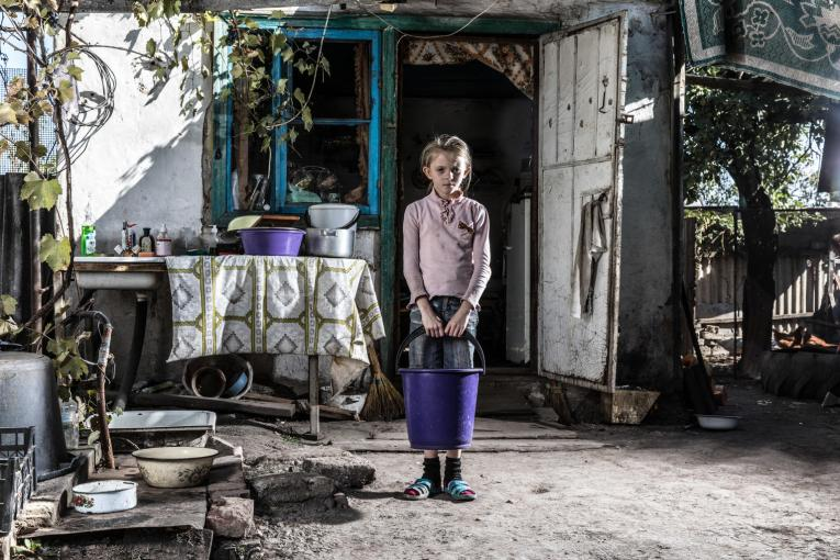 Due to conflict in eastern Ukraine, nine-year-old Sasha has never had running water at her home. Instead, she must collect water from the river.