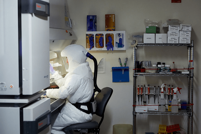 Staff scientist Laura VanBlargan, PhD, works with the virus that causes COVID-19 under high biosafety conditions at Washington University School of Medicine in St. Louis. VanBlargan co-led a study that identified an antibody that is highly protective against a broad range of viral variants