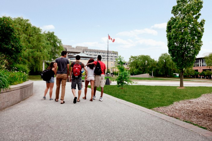 Students walk together in the York U Commons