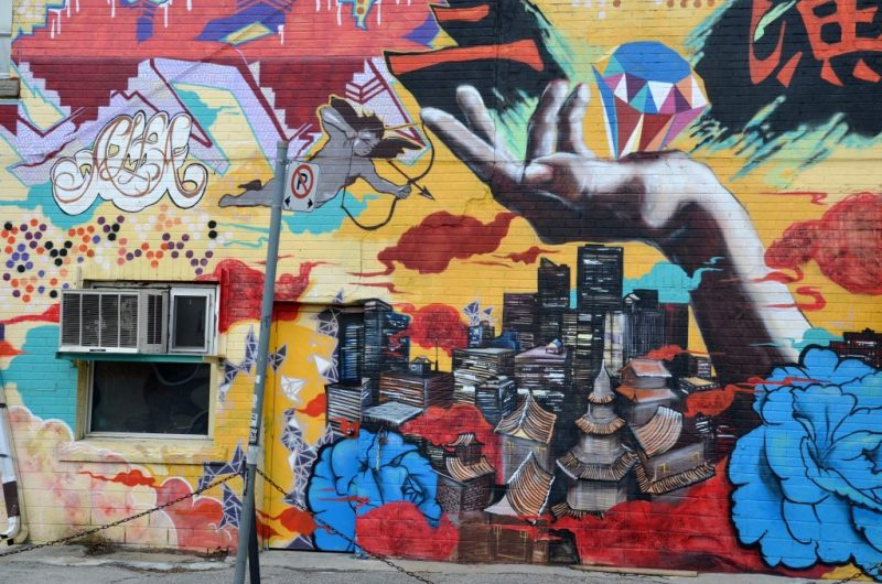 Image of colourful graffiti on a wall downtown by JonasJovaisis from Pixabay.