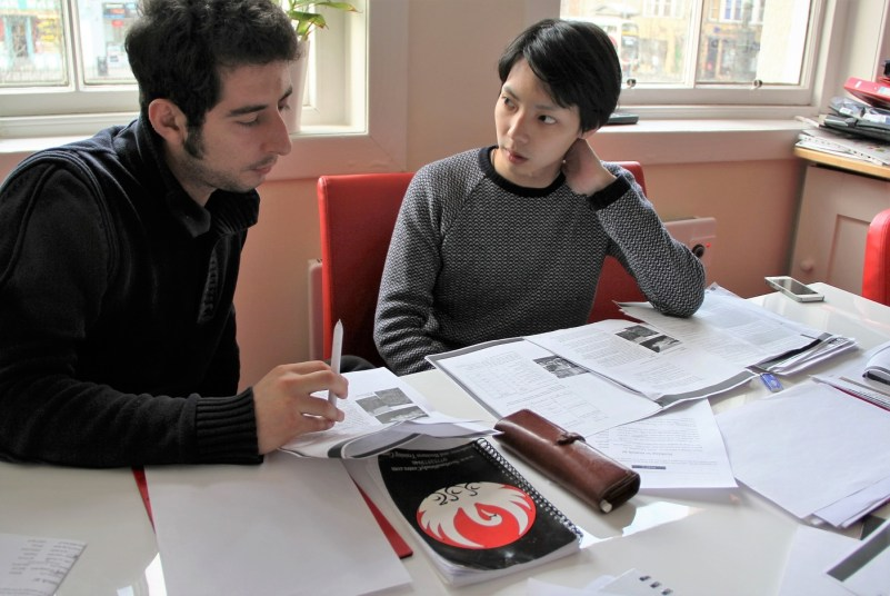 An image of two students talking.