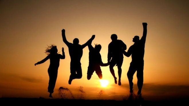 friends jumping together in silhouette-2