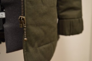 Metal zipper and arm