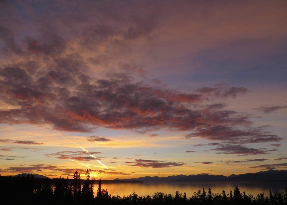 Pink and orange sunset over Kluane Lake, Yukon
