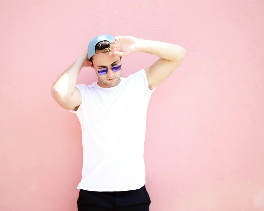 Chris Lin wearing a plain white tee