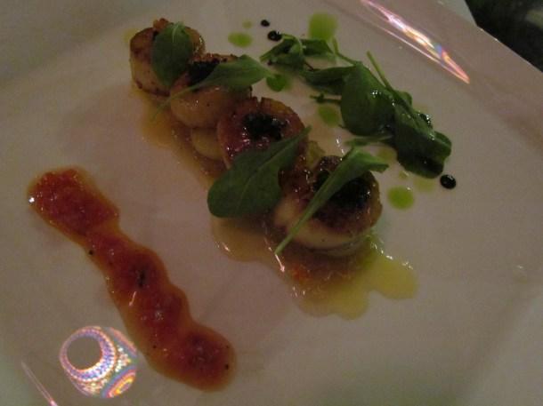 pan seared Canadian sea scallops on thyme fondant, roasted shallots, noilly prat sauce, caviar & micro greens
