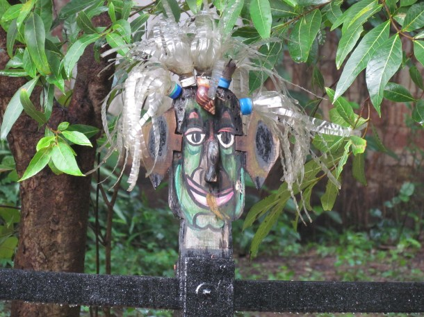 scarecrow made with metal - hair made with plastic bottles!!!!
