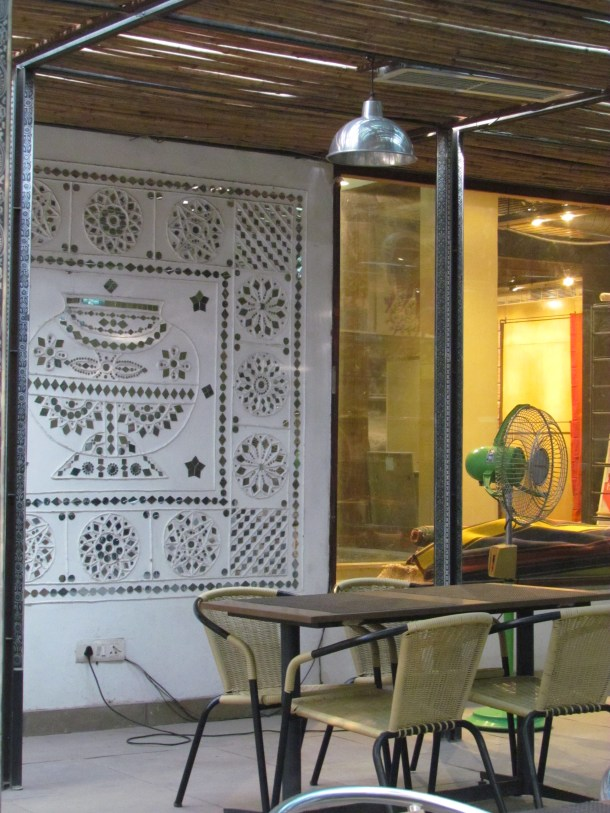 A Gujarati wall mural - on the foreground & Lota shop in the background