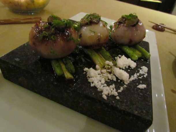 Hokkaido scallops truffles asparagus tamari soy served on hot black stone