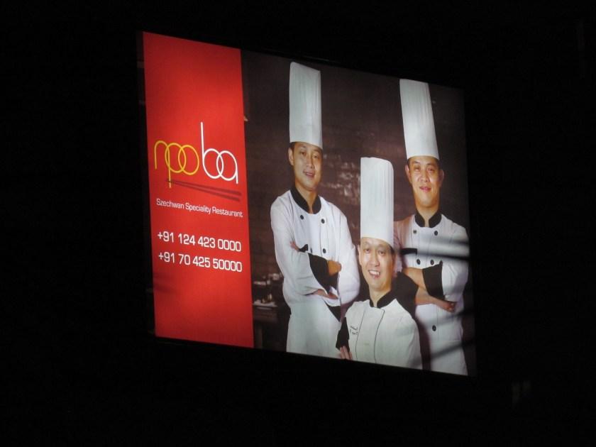 billboard outside restaurant