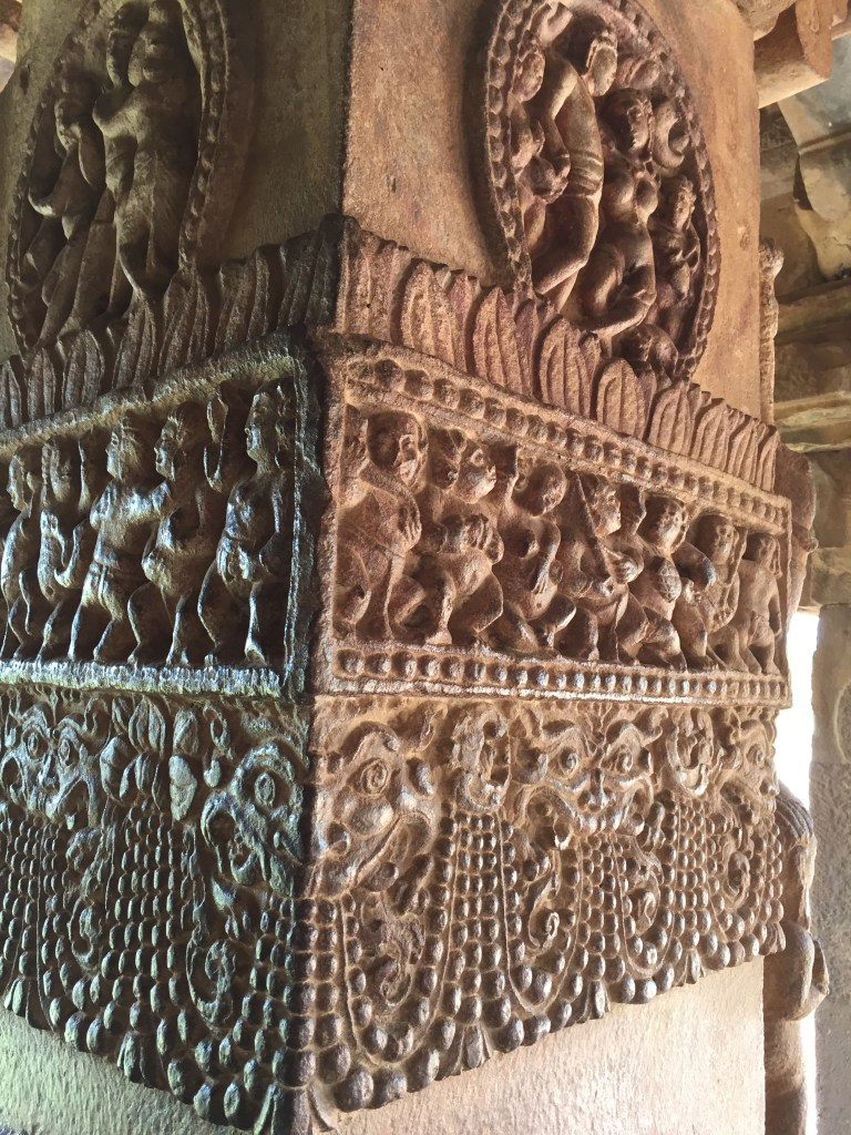 Intricate designs carved  on rock pillar