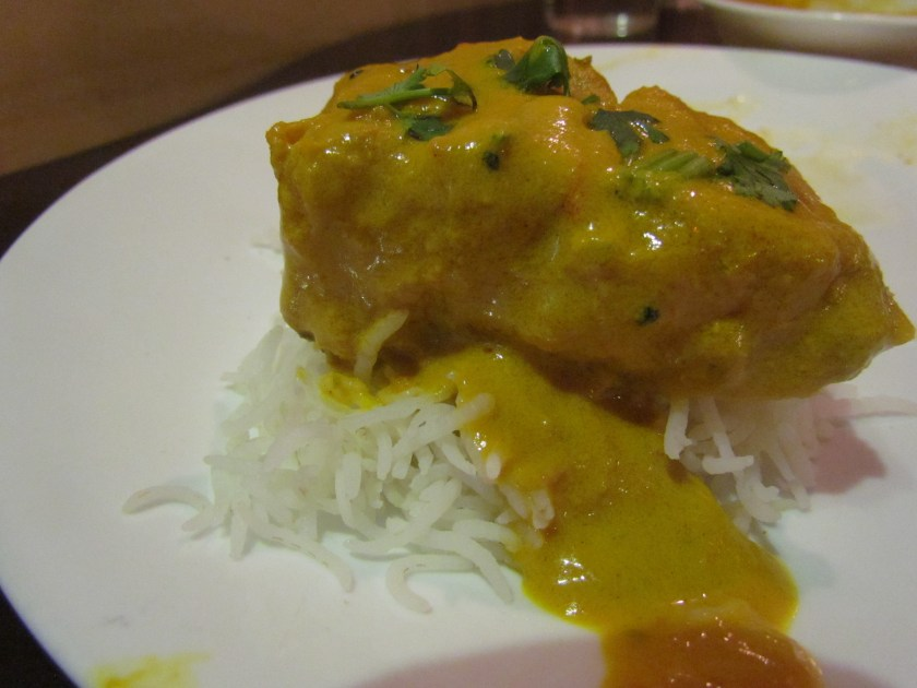 Bhetki in Mustard - placed on a bed of plain rice