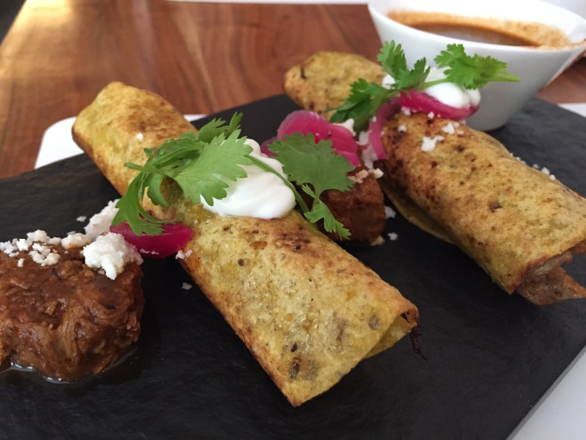 Fried tacos of slow cooked lamb with ancho chili sauce