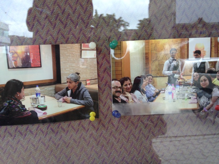 A framed board in restaurant showing Bollywood actors dining here