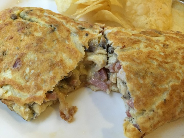 Stuffed omelet with ham and mushroom