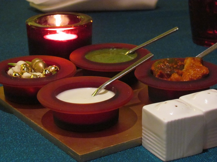 on the table - a lovely green chutney & a garlic flavored white sauce