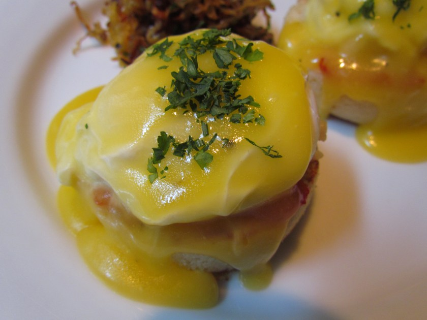 Eggs benny with butter poached Lobster, confit tomatoes and hollandaise