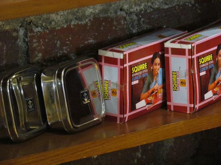 retro tiffin boxes stacked in a corner
