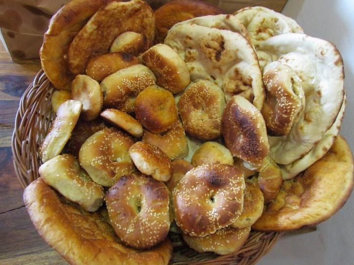 An array of kashmiri breads freshly baked