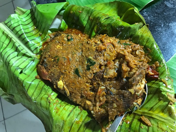 Karimeen pollichatu came wrapped in a banana leaf