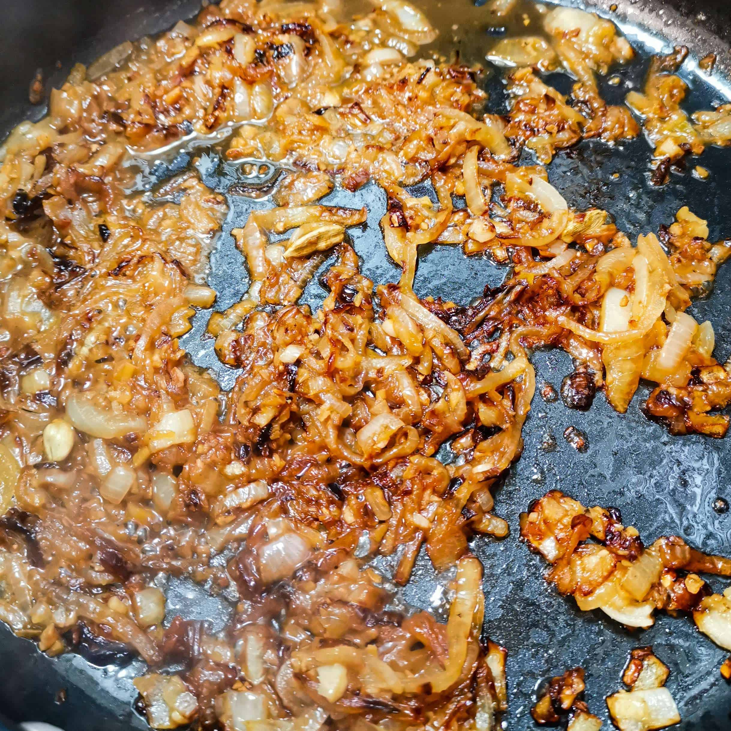 Onions in a pan water frying for a curry
