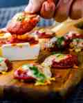 Low Carb Mini Pizzas dipped in pizza sauce