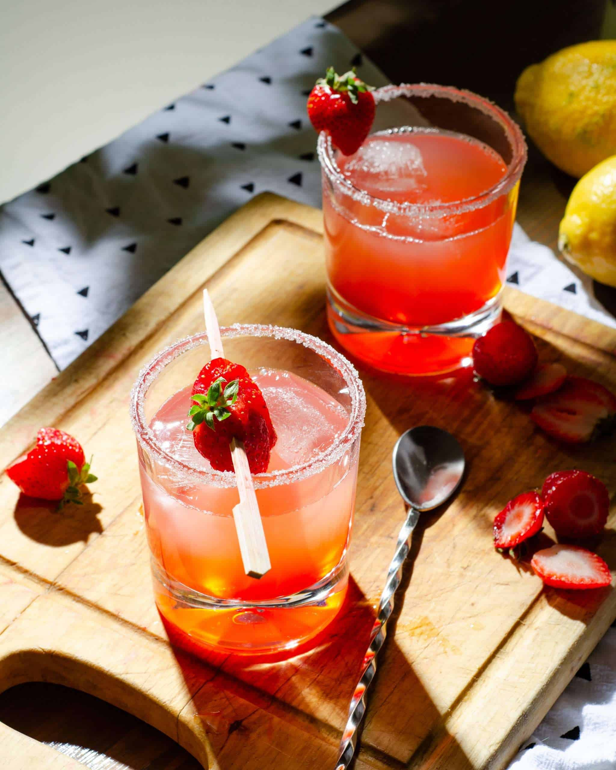 Low carb strawberry lemonade cocktail and a table outside