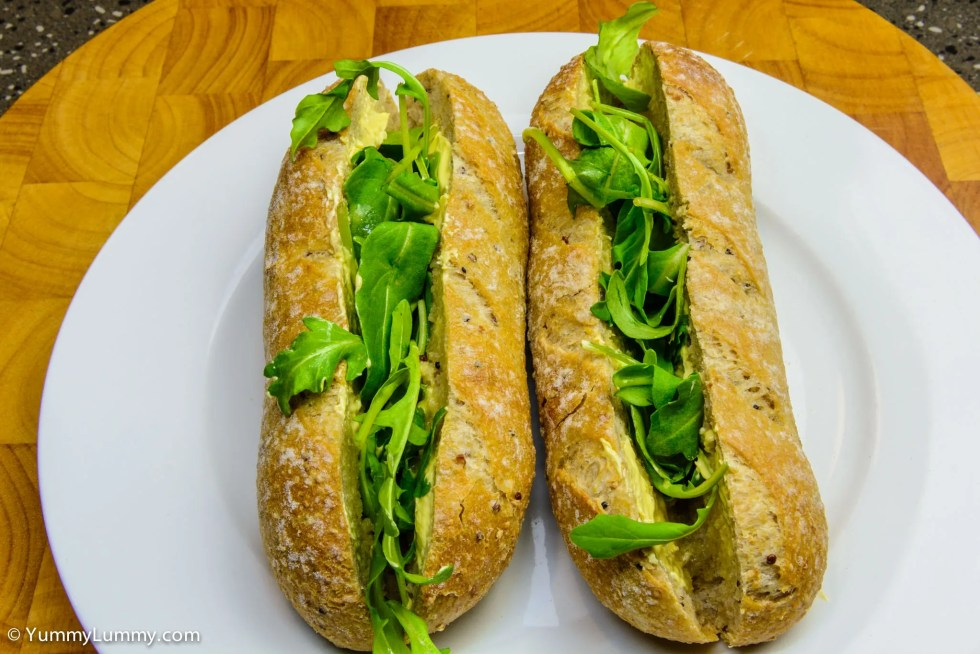 Wholemeal and quinoa pane di casa with lashings of butter and a layer of roquette