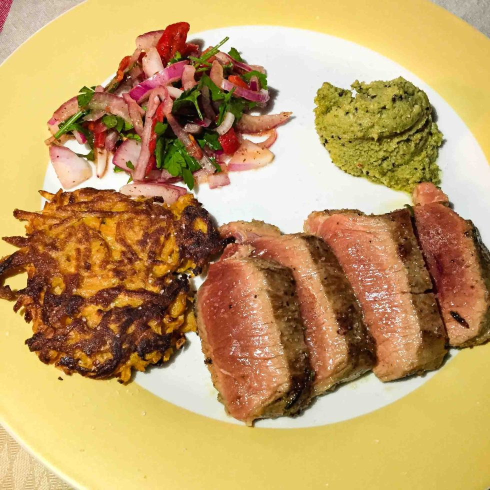 Lamb backstrap with peanut and coconut crème, red onion salsa, and sweet potato cake