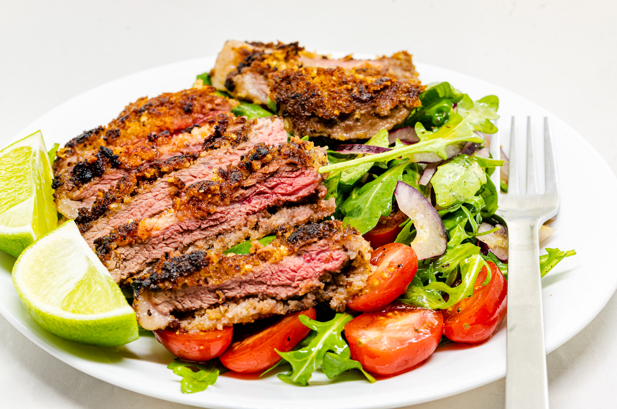 Crumbed, nutted, and beaten rump steak