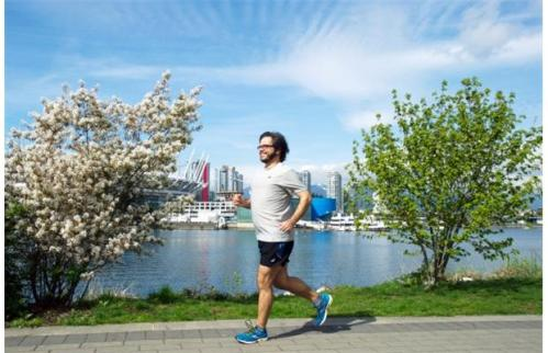 Yuri Artibise enjoys a sunny run along the Vancouver seawall,