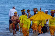 The worshippers collect seawater