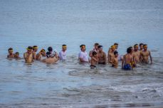 Now the men are bathing in the sea